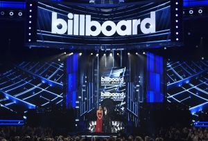 Hosts Chrissy Teigen, left, and Ludacris speak at the Billboard Music Awards at the MGM Grand Garden Arena on Sunday, May 17, 2015, in Las Vegas. (Photo by Chris Pizzello/Invision/AP)